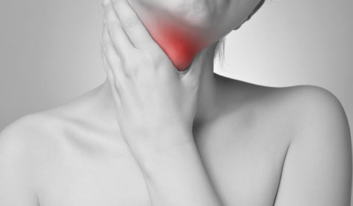 woman-holding-glowing-red-throat