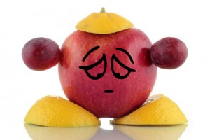Diet problem. Funny fruit, emoticon on white background